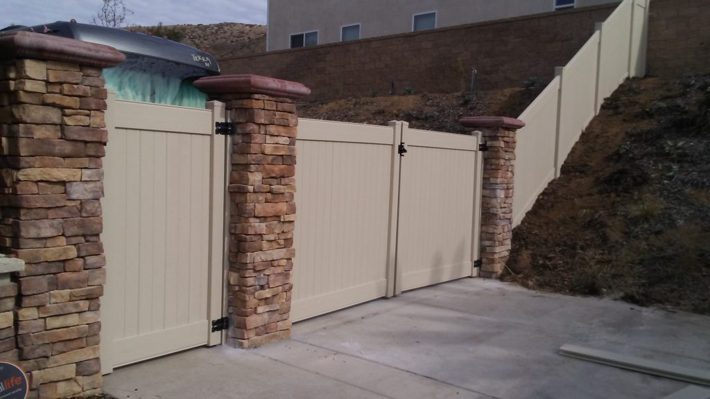 Tan Vinyl Gates installed in Norco Ca.