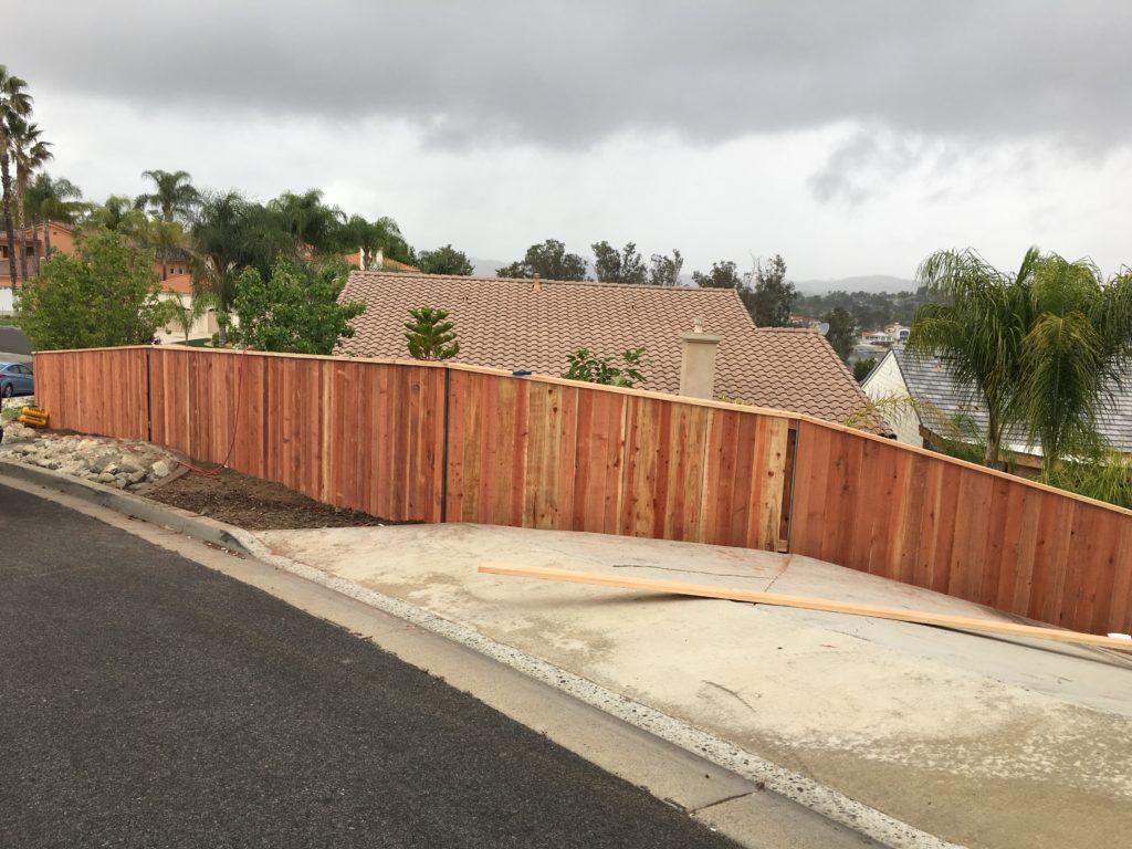 Redwood cap & trim Fence