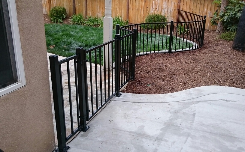 Black wrought iron fence and gate
