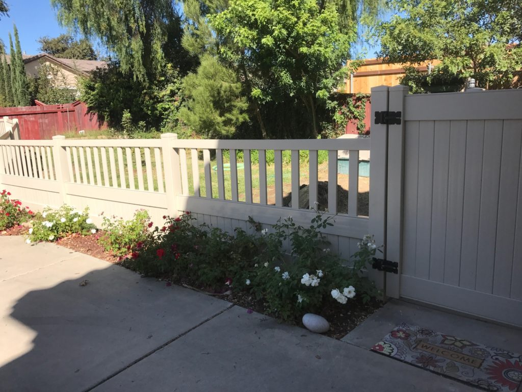 Tan Vinyl picket and privacy combo fence