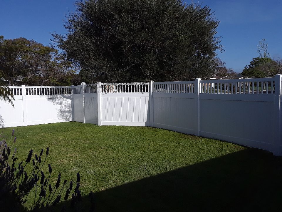 White Vinyl Fence w/ picket top